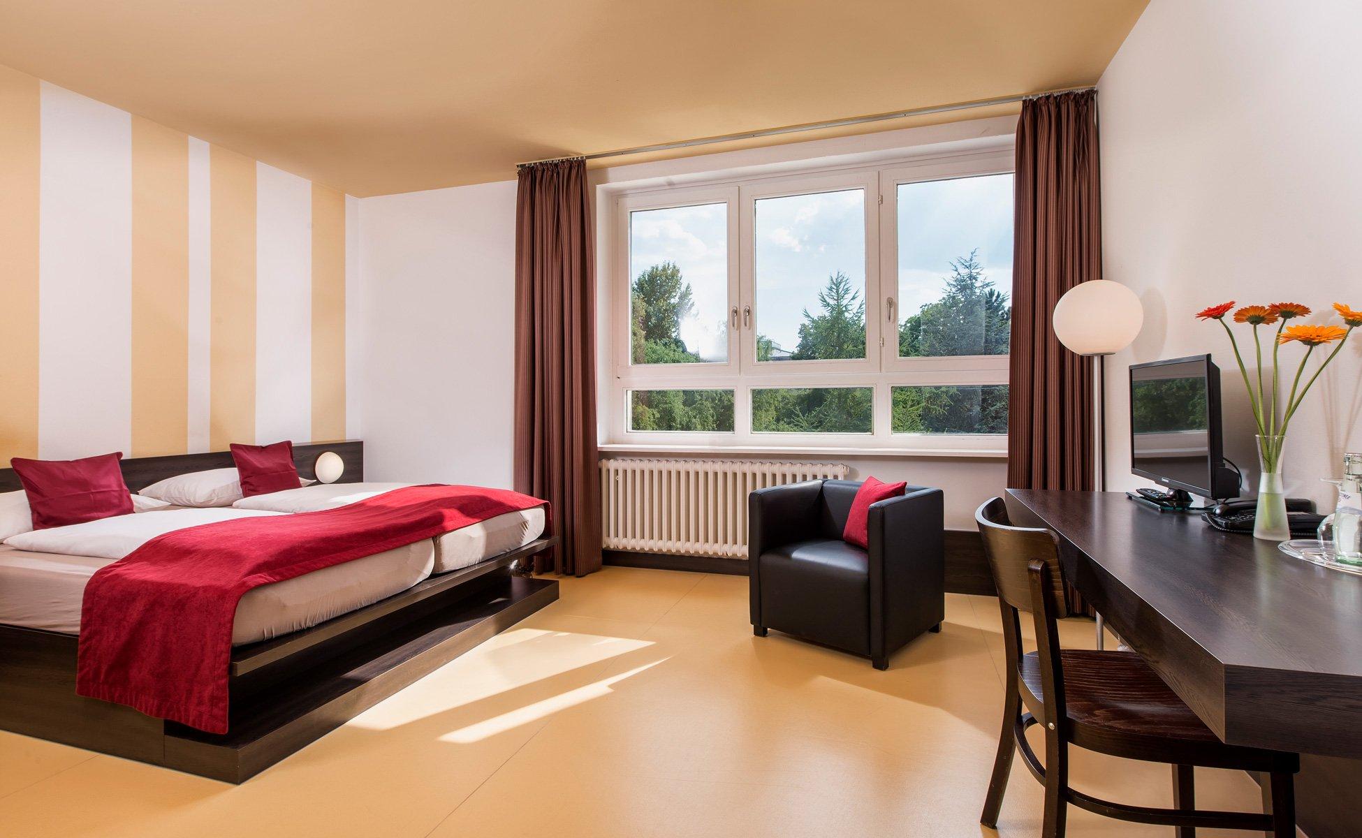 Hotel-Grenzfall Zimmer-Gartenblick Gesamtansicht